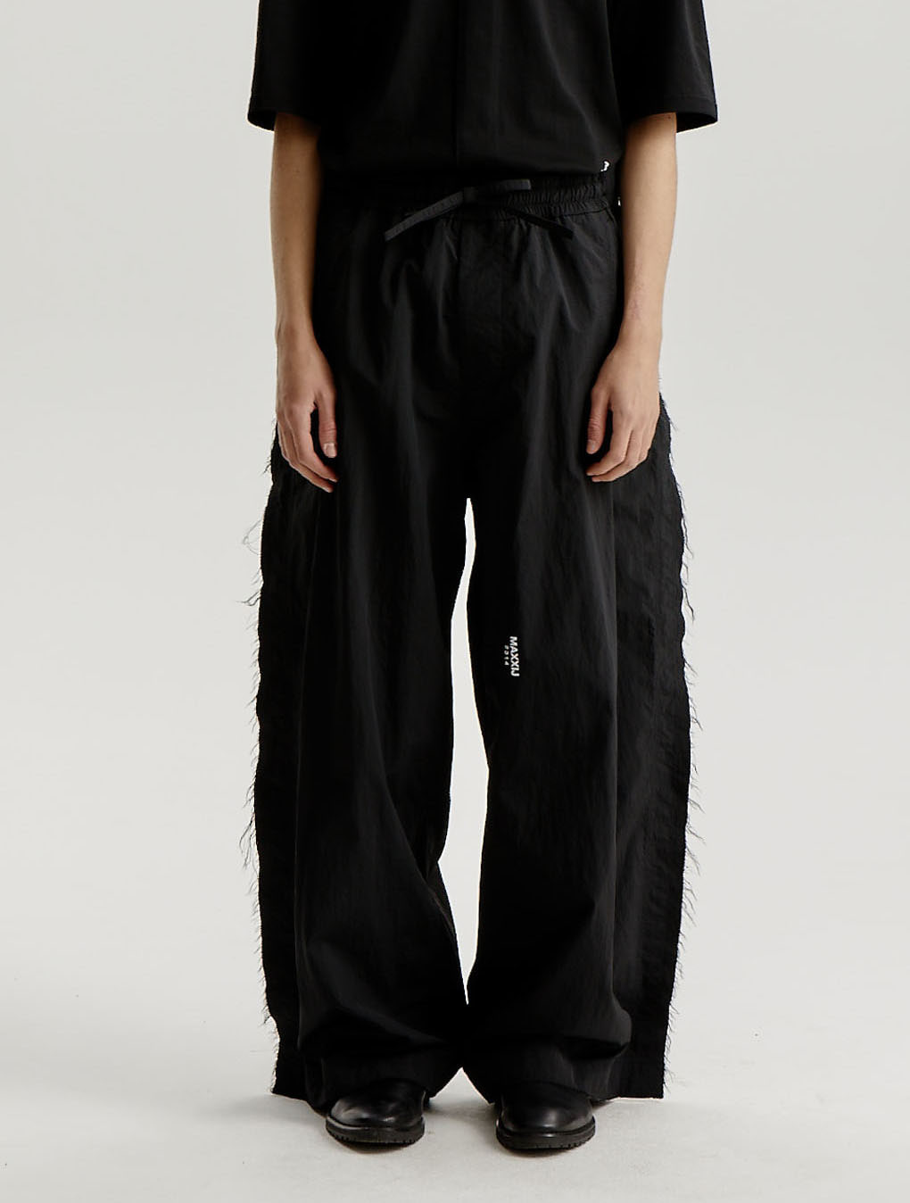 Black Nylon Distressed Wide Trousers